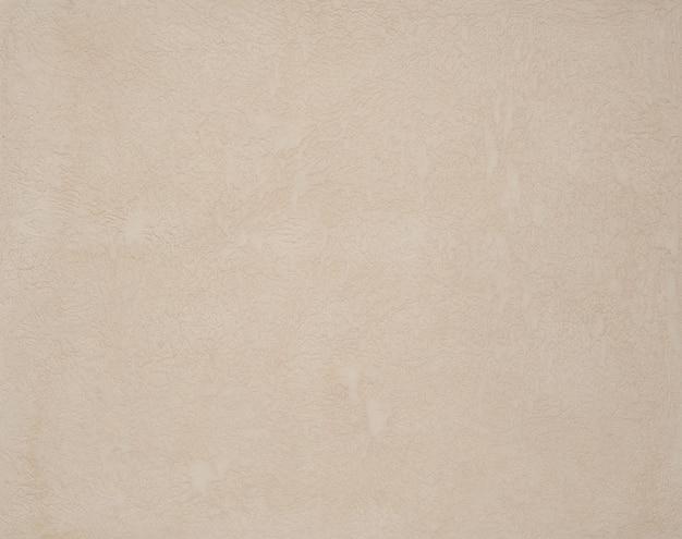Sfondo di intonaco strutturato beige chiaro. sfondo artistico