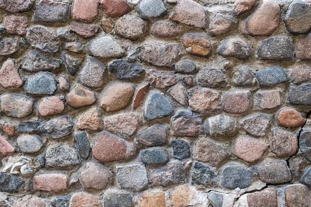 Sfondo, muro di pietra naturale, grandi massi e cemento