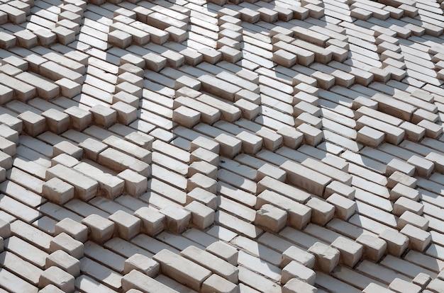 Sfondo di mattoni bianchi sotto forma di rombi.