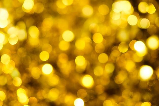 Sfondo con luci scintillanti dorate sfocate che occupano l'intera immagine