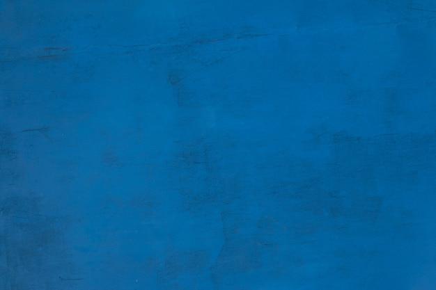 Sfondo con struttura della parete con vecchia vernice blu.