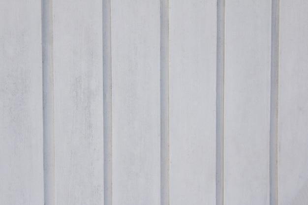 Sfondo con struttura in legno bianco.