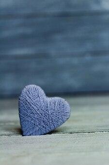 Sfondo con cuore in legno, san valentino