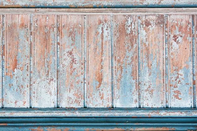Tavola di legno di sfondo con vernice incrinata.