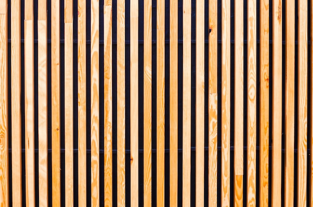 Sfondo di assi di legno, doghe. architettura moderna, urbana. struttura in legno sfondo del designer