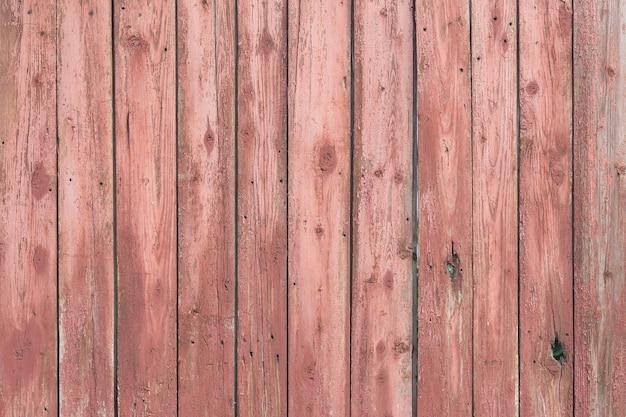 Sfondo di staccionata in legno ed erba verde