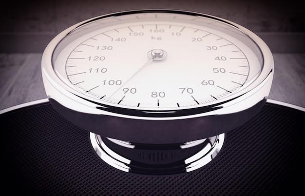 Bilancia con i numeri che misurano il peso