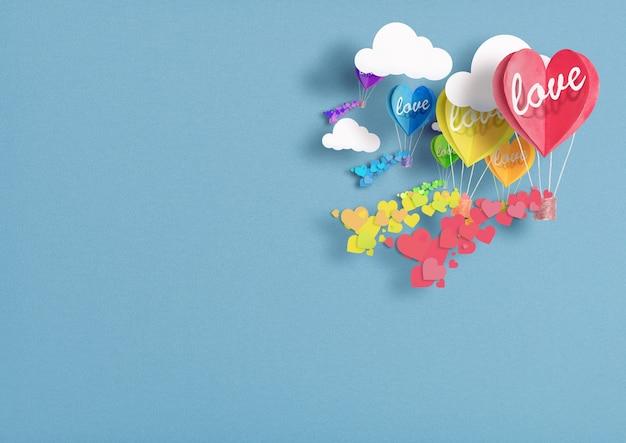 Palloncini a forma di cuore dipinti in colori lgbt che volano tra le nuvole con amore su di loro. concetto di libertà e tolleranza