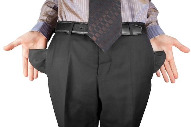 Uomo d'affari in bancarotta che mostra le mani vuote tasche