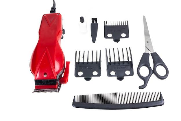 Tagliatori di rosso del barbiere su fondo bianco.