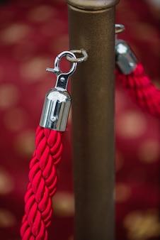 Barriera con corda rossa, concetto di cinema