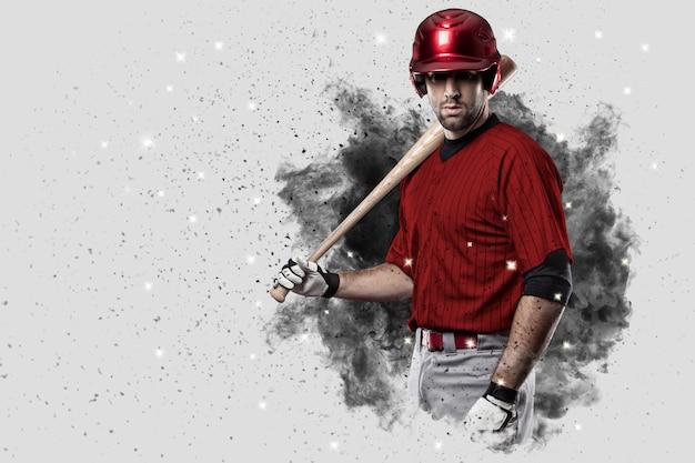 Giocatore di baseball con un'uniforme rossa che esce da una raffica di fumo.
