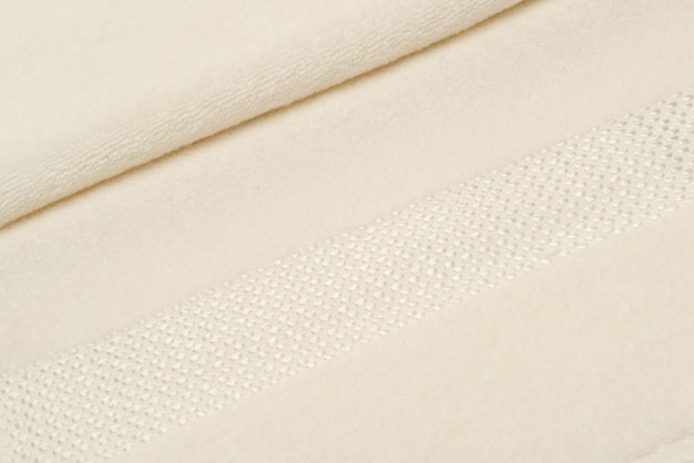 Telo da bagno con piega. sfondo di tessuto strutturato
