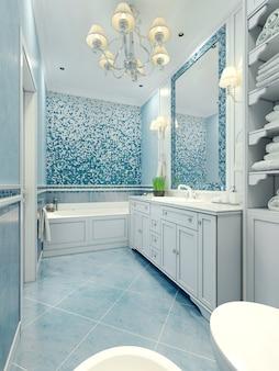 Bagno in stile art déco con un mix di piastrelle e intonaco di colore azzurro e pareti in mosaico e specchio con cornice.