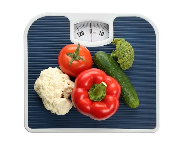 Bilancia pesapersone con verdure
