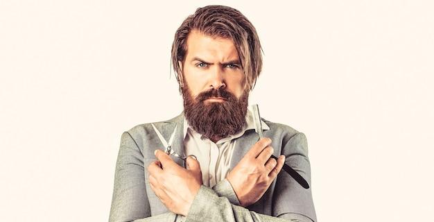 Uomo barbuto, maschio barbuto. ritratto di barba uomo alla moda. forbici da barbiere e rasoio, negozio di barbiere. barbiere vintage, rasatura