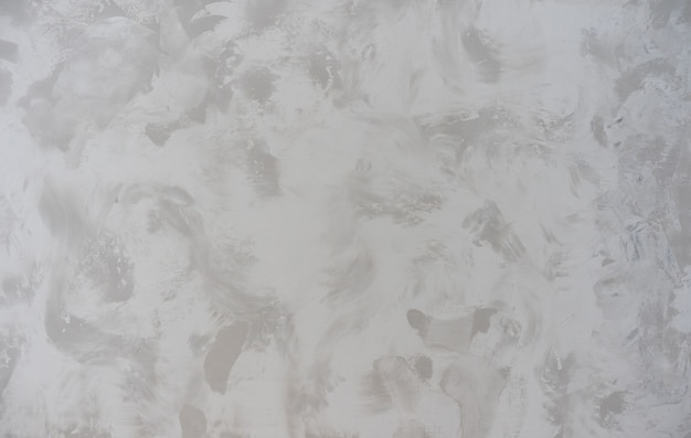 Bello fondo dallo stucco veneziano decorativo del primo piano di struttura sul gray della superficie della parete
