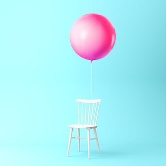 Bello rosa dell'aerostato con il concetto della sedia su fondo blu pastello. concetto di idea minima.