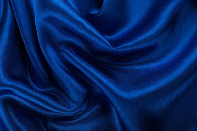 Bello fondo di struttura del tessuto di seta blu