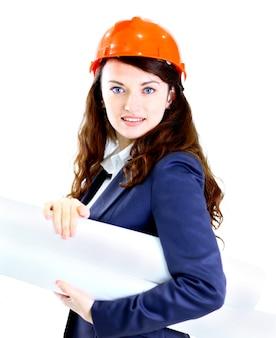 Bello ingegnere della donna di affari con l'ufficio del piano di lavoro.