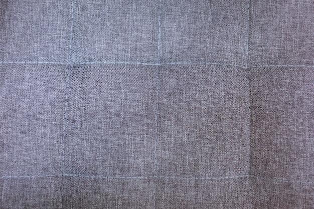 Bellissimo sfondo grigio testurizzato realizzato in materiale di primo piano, tessuto per mobili