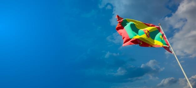 Bella bandiera nazionale dello stato di grenada con uno spazio vuoto su sfondo ampio