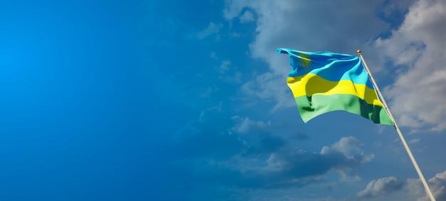 Bella bandiera nazionale dello stato del ruanda sul cielo blu