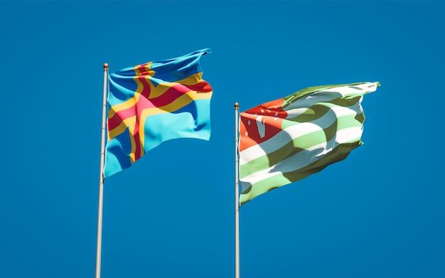 Belle bandiere dello stato nazionale dell'abkhazia e delle isole aland insieme