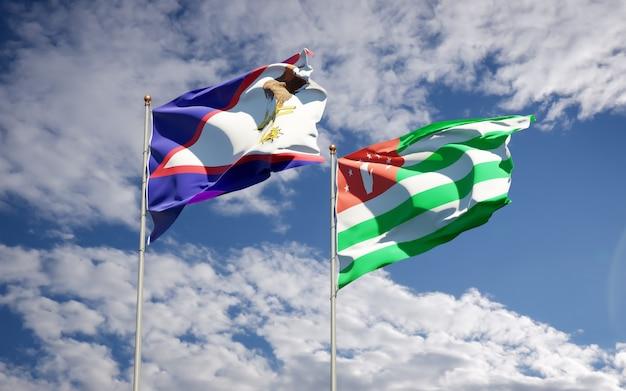 Belle bandiere di stato nazionali dell'abkhazia e delle samoa americane insieme
