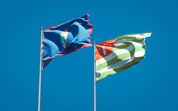 Belle bandiere nazionali di stato dell'abkhazia e del guam insieme