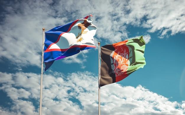 Belle bandiere di stato nazionali dell'afghanistan e delle samoa americane Foto Premium
