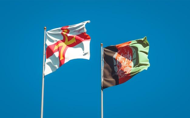 Belle bandiere di stato nazionali dell'afghanistan e di guernsey