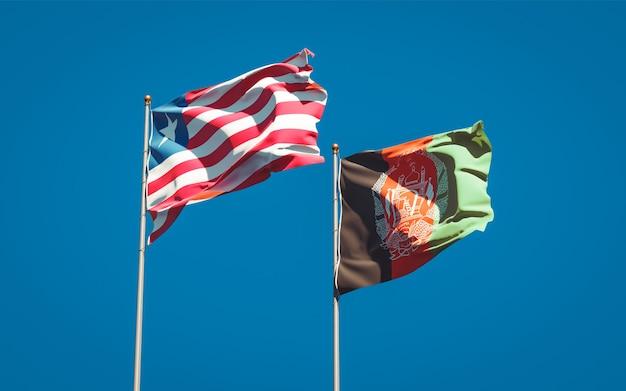 Belle bandiere di stato nazionali dell'afghanistan e della liberia