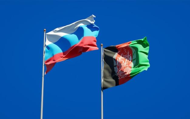 Belle bandiere di stato nazionali dell'afghanistan e della nuova russia