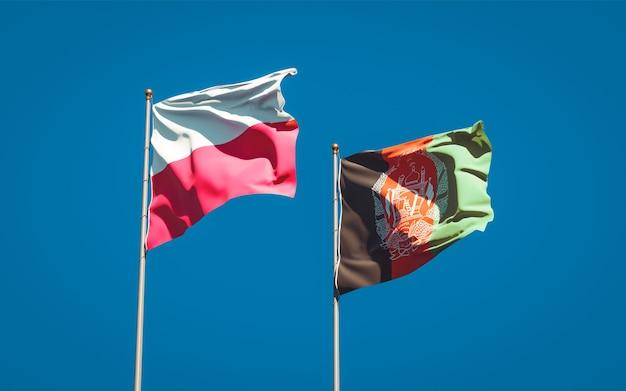 Belle bandiere di stato nazionali dell'afghanistan e della polonia