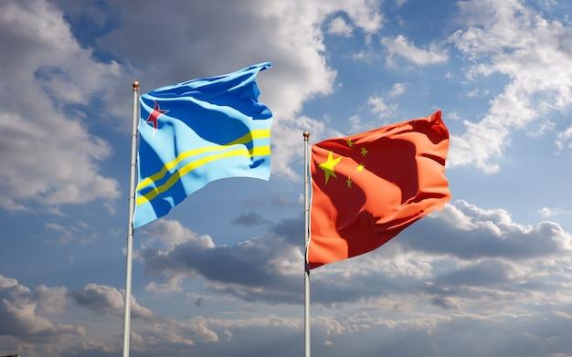 Belle bandiere nazionali dello stato della cina e aruba insieme al cielo