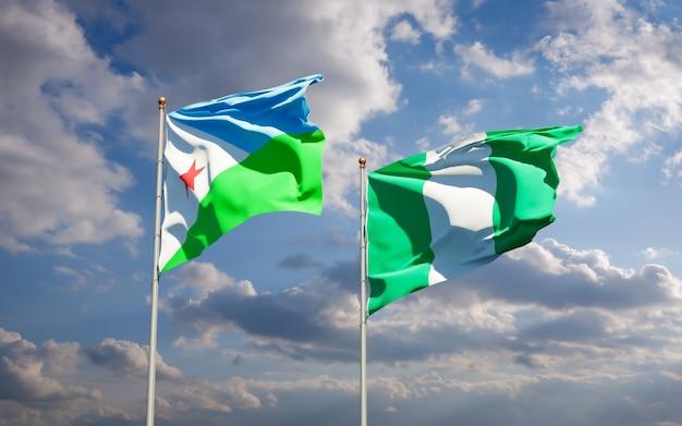 Belle bandiere di stato nazionali di gibuti e nigeria insieme sul cielo blu