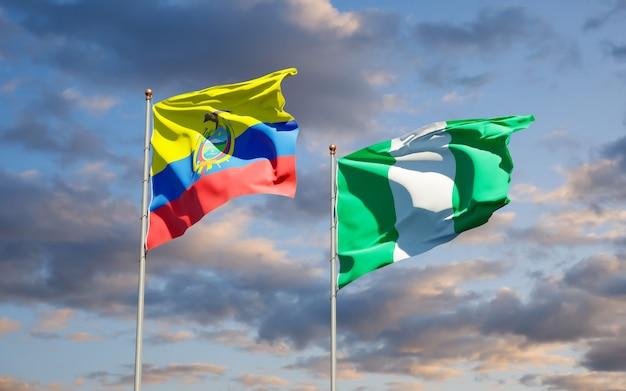 Belle bandiere di stato nazionali dell'ecuador e della nigeria insieme sul cielo blu