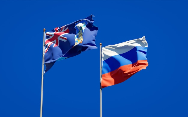 Bandiere di stato nazionale belle delle isole falkland e della russia insieme sul cielo blu. grafica 3d