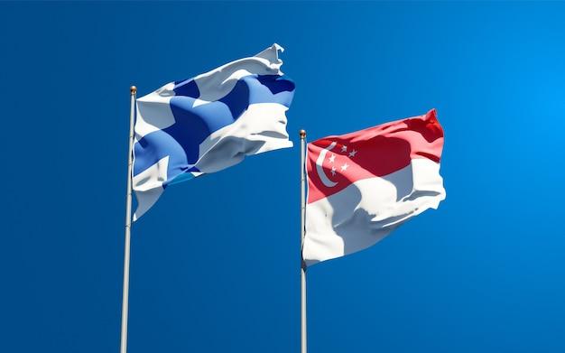 Belle bandiere di stato nazionali di finlandia e singapore insieme