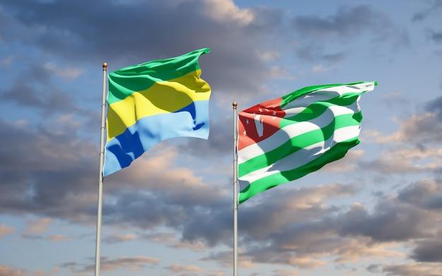 Belle bandiere nazionali dello stato del gabon e dell'abkhazia insieme