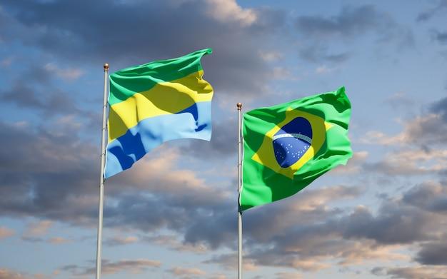 Belle bandiere nazionali dello stato del gabon e del brasile insieme sul cielo blu