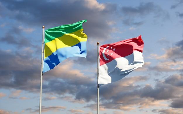 Belle bandiere nazionali dello stato del gabon e singapore insieme