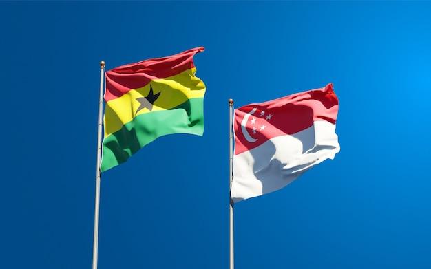 Belle bandiere di stato nazionali del ghana e singapore insieme