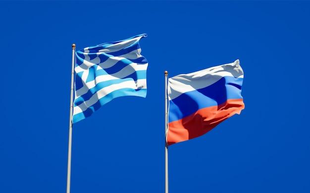 Belle bandiere di stato nazionali della grecia e della russia insieme sul cielo blu. grafica 3d