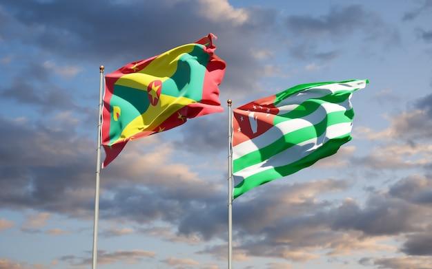 Belle bandiere nazionali dello stato di grenada e abkhazia insieme
