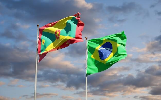 Belle bandiere dello stato nazionale di grenada e brasile insieme sul cielo blu