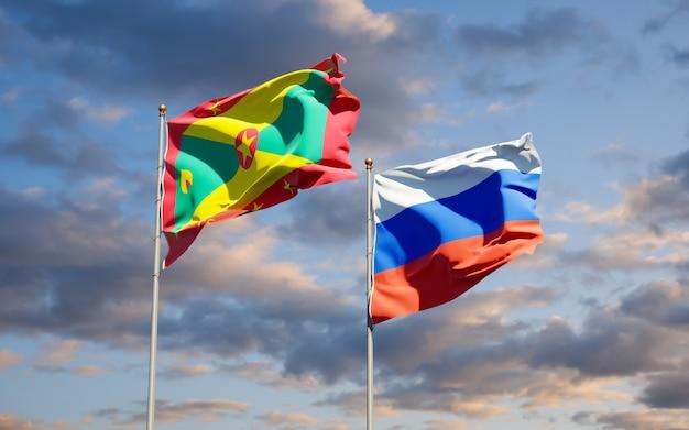 Belle bandiere nazionali dello stato di grenada e russia insieme sul cielo blu. grafica 3d