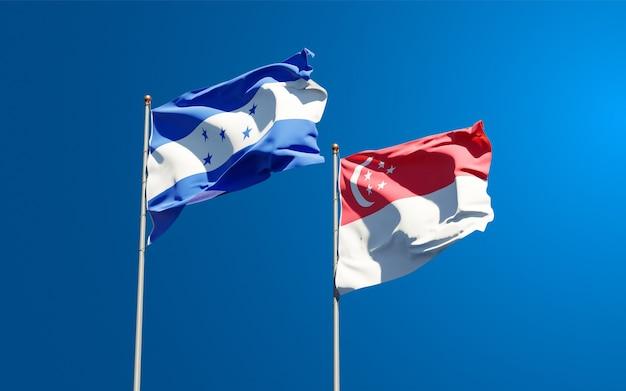 Belle bandiere di stato nazionali di honduras e singapore insieme