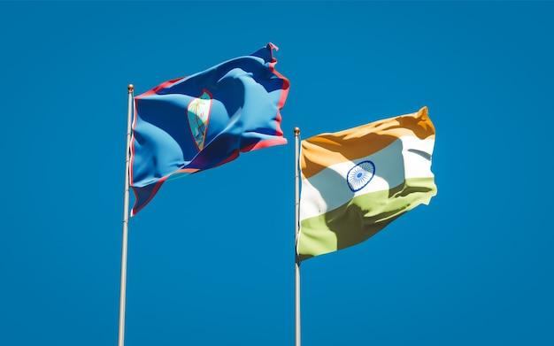 Belle bandiere nazionali dello stato dell'india e del guam insieme